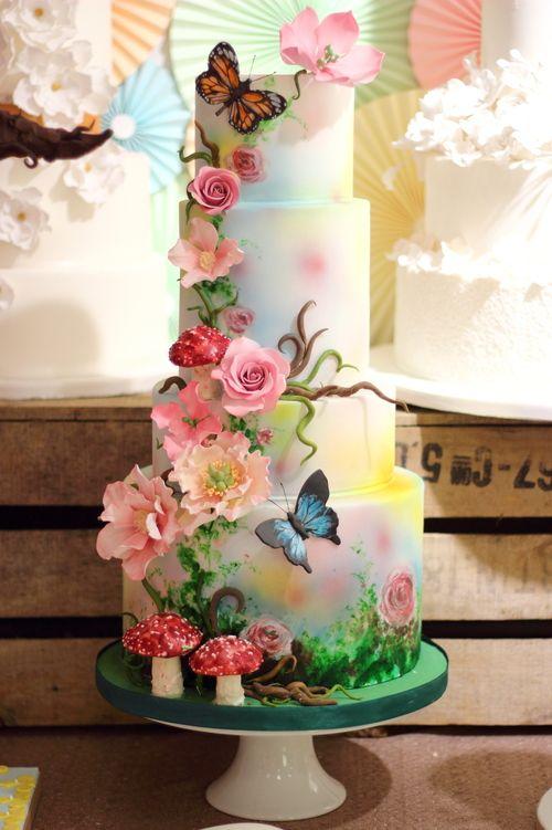 Woodland magical themed wedding cake with painted butterflies and woodland magical themed wedding cake with painted butterflies and toadstools junglespirit Choice Image